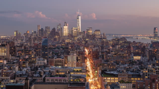 time lapse bird's eye aerial view downtown manhattan nyc skyline world trade center. sunset. day to night transition - world trade center manhattan video stock e b–roll