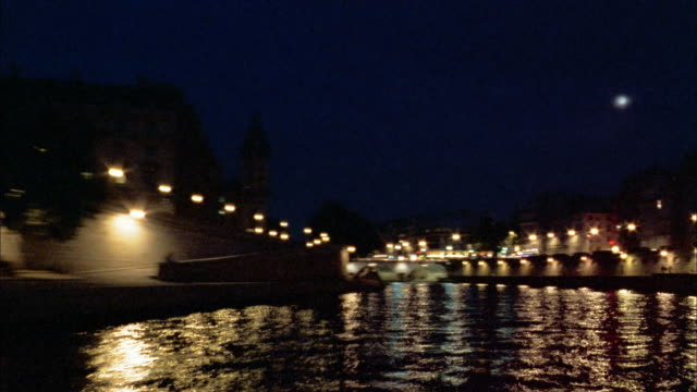time lapse boat point of view down seine river in paris at night - 2002 stock videos & royalty-free footage