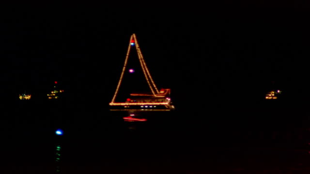 Time lapse boats sailing past each other in Pacific at night / California