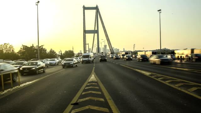 hd time lapse boshorus bridge - july 15 martyrs' bridge stock videos and b-roll footage