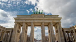 Time lapse. Brandenburg Gate or Brandenburger Tor in Berlin, Germany is a famous national landmark and tourist attraction at Unter den Linden, in the Mitte part of the German capitol City