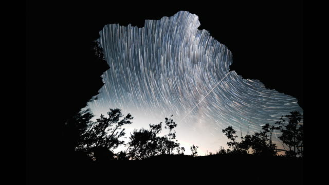 time lapse: breathtaking night sky from a cave, blue mountains, australia - art stock videos & royalty-free footage