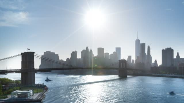 time lapse zo of brooklyn bridge and downtown manhattan skyline - brooklyn bridge stock videos and b-roll footage