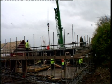Time lapse builders putting up prefabricated timber house Northampton