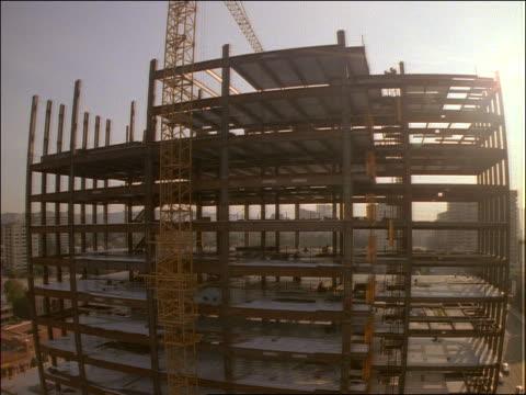 time lapse building under construction at sunrise