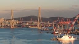 4K Time lapse : Busan harbor bride , Busan City skyline  at South Korea