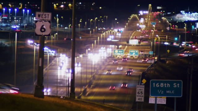 Time lapse busy traffic at night on a multilane highway, 'West 6.'