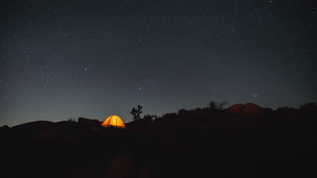 time lapse camping at night in joshua tree national park - astronomy stock videos & royalty-free footage