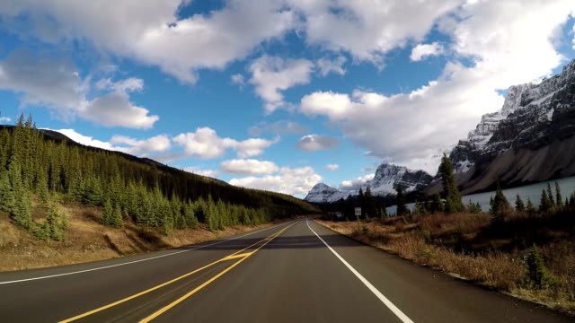 Time lapse POV car driving on scenic road