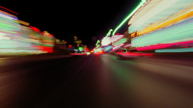 time lapse car point of view blurred traffic + neon lit buildings in Las Vegas / Nevada, USA