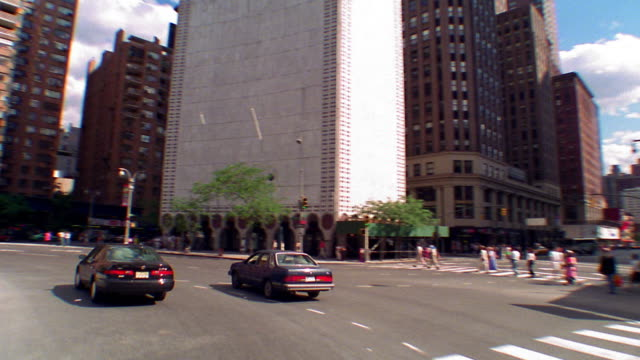 time lapse car point of view driving around Columbus Circle past Trump Hotel + down Broadway / NYC