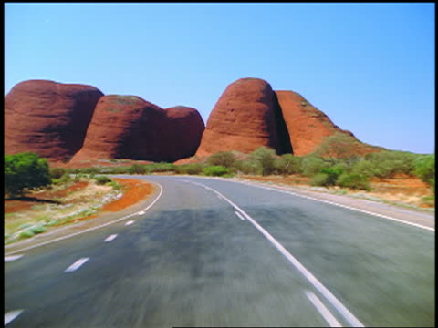 time lapse car point of view driving on highway towards rock formations / kata tjuta / northern territory, australia - car point of view stock videos & royalty-free footage