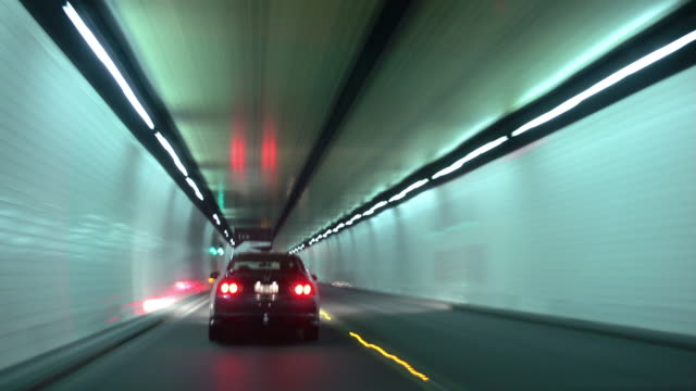 time lapse car point of view driving through road tunnel following car / lyttelton road tunnel, new zealand - car point of view stock videos & royalty-free footage