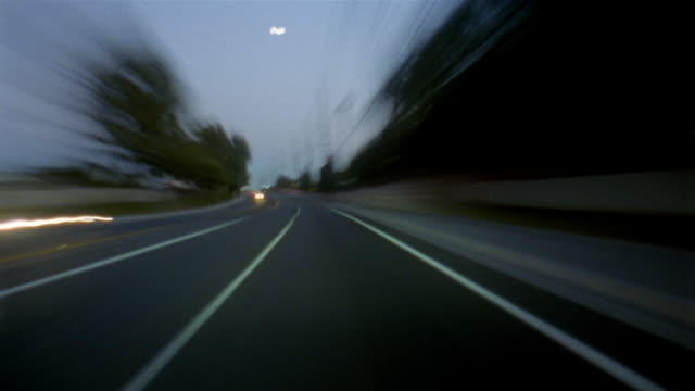 Time lapse car point of view driving through streets of Lake Forest / dusk to night / Orange County, CA