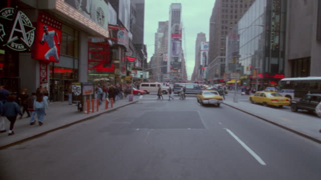 time lapse car point of view in traffic on broadway (thru times square) / new york city - anno 1997 video stock e b–roll