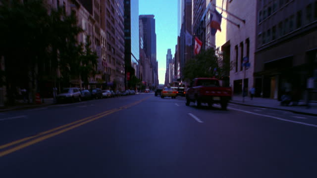 time lapse car point of view in traffic through intersections on 57th street / manhattan, new york city - 2001 stock videos and b-roll footage