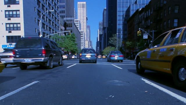 time lapse car point of view in traffic through intersections on city street / manhattan, new york city - 2001 stock videos and b-roll footage
