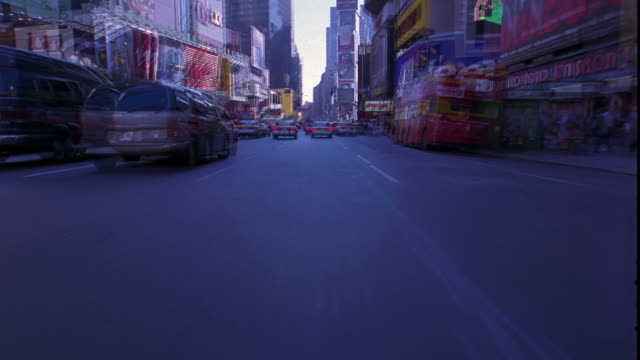 time lapse car point of view in traffic through intersections through times square / manhattan, new york city - 1998 stock videos and b-roll footage
