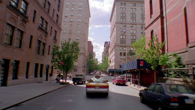 time lapse car point of view moving west on NYC street towards Central Park / turns + goes down Fifth Avenue