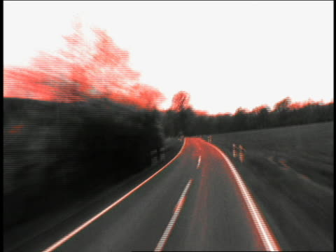 vídeos de stock, filmes e b-roll de time lapse car point of view on country road with fields and trees on either side / germany - superexposto
