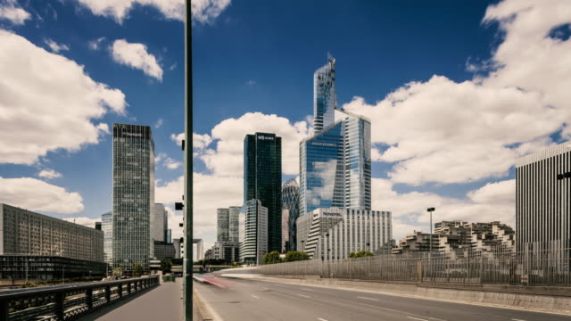 time lapse car traffic on bridge driving to la défense business / financial district of paris - ward stock videos and b-roll footage