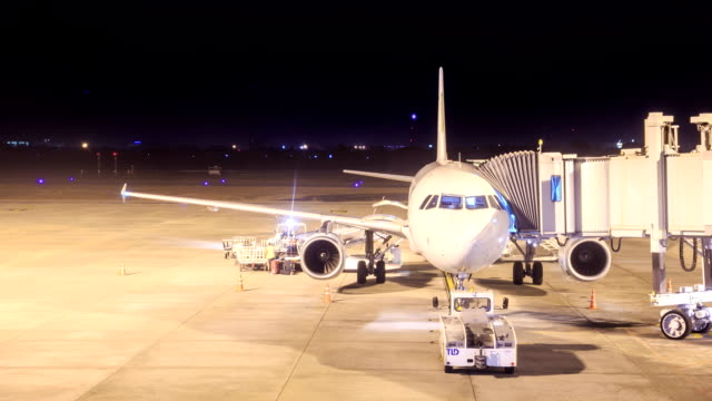 hd time lapse : cargo loading to plane - full hd format stock videos & royalty-free footage