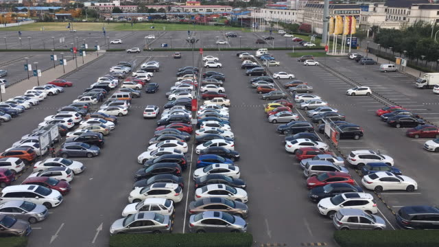time lapse: cars driving in and out of parking lot