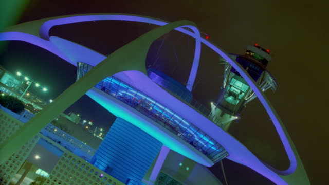 CANTED time lapse changing colors on LAX Theme Building + control tower at night / Los Angeles