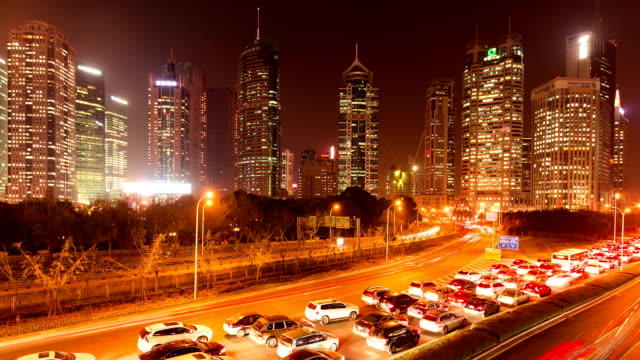 time lapse - chinese central shanghai night traffic - yellow background stock videos and b-roll footage