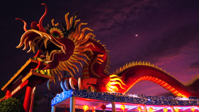 4k time lapse chinese dragon with sky backgrounds - dragon stock videos & royalty-free footage