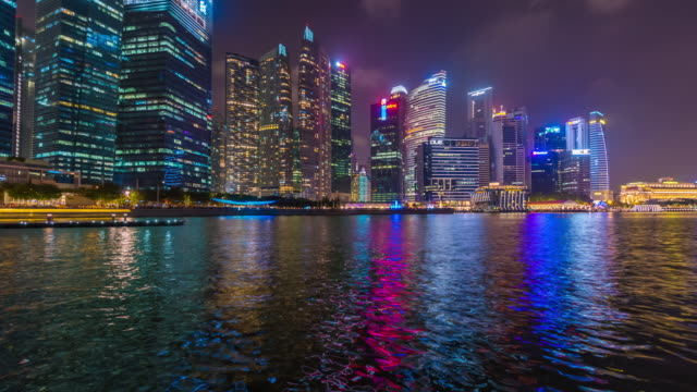 4k time lapse :   city skyline, marina bay and raffles place view at night - raffles city stock videos & royalty-free footage