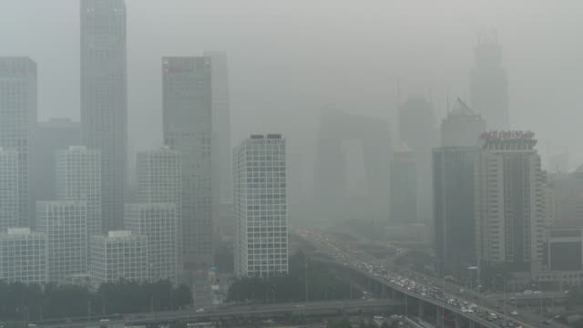 time lapse- city under siege-beijing air pollution (zoom) - beijing stock videos & royalty-free footage