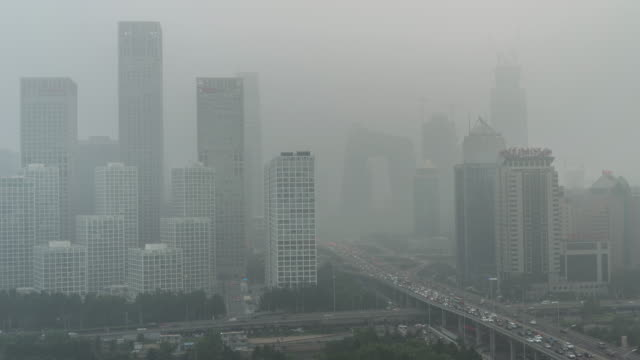 time lapse- city under siege-beijing air pollution - air pollution stock videos & royalty-free footage