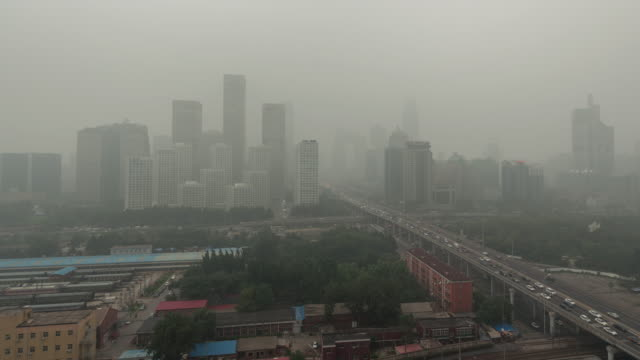 time lapse- cityscape of beijing in air pollution (lr pan) - air pollution stock videos & royalty-free footage