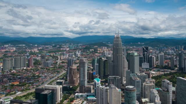 time lapse : cityscape of kuala lumpur skyline, malaysia - petronas twin towers stock videos and b-roll footage
