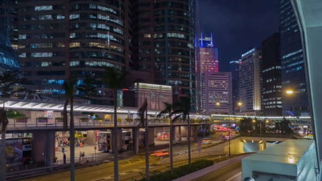 4k time lapse : cityscape time lapse at night in hong kong.cities and architecture - embassy stock videos & royalty-free footage