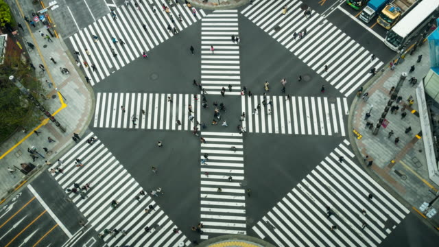 4k time lapse clip of people and car crowd with aerial view pedestrians intersection cross-walk ginza crosswalk car traffic on tokyo city. japan, japanese culture concept - zebra crossing stock videos & royalty-free footage