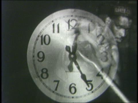 vídeos de stock e filmes b-roll de time lapse clocks + men shovelling - filme colagem