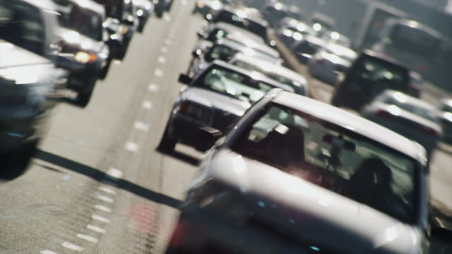 Time lapse close up of  commuter traffic congestion racing around curve toward camera on the Ben Franklin Bridge.
