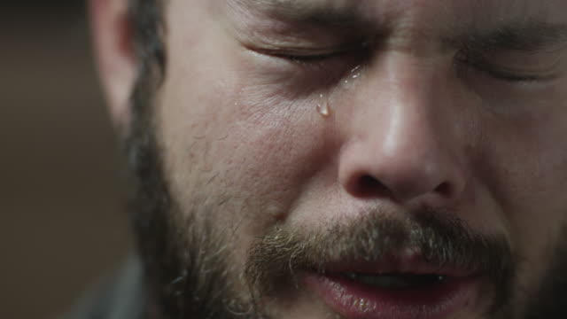 Time lapse close up shot of tear running down bearded mans face / Orem, Utah, United States,