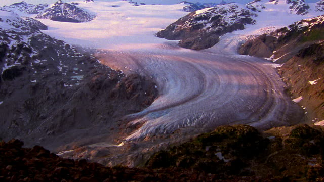 Time lapse cloud shadows over top of glacier / Coast Mountains, Whistler, British Columbia
