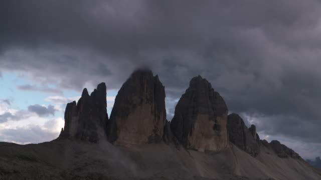 Time Lapse. Clouds at the peak of Tre Cime Di Lavaredo (mountain). Tre Time Di Lavaredo, Sexten Dolomites, Dolomites, European Alps, Alto Adige, South Tyrol, Italy.