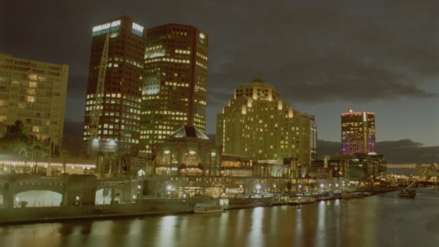 time lapse clouds behind buildings on southbank / dusk to night / melbourne, victoria, australia - 1999 stock videos & royalty-free footage