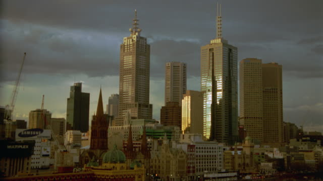 time lapse clouds / day to twilight over melbourne skyline / victoria, australia - 1999 stock videos & royalty-free footage
