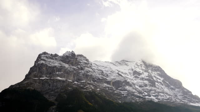 Time lapse clouds float in mountain near Grindelwald Switzerland.