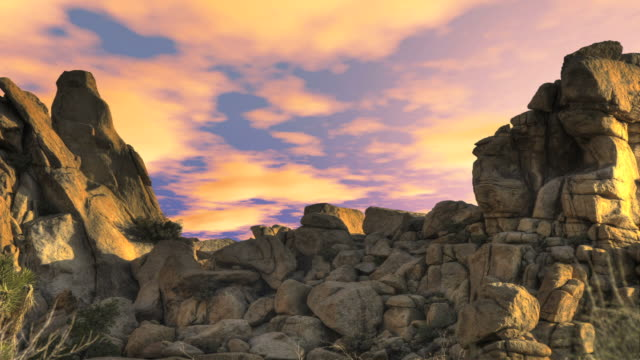 time lapse clouds float over rock formations. - digital enhancement stock videos and b-roll footage
