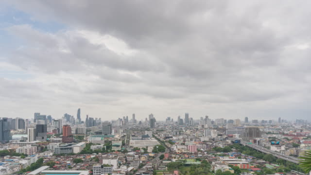 Time lapse Clouds float over the city before rain.