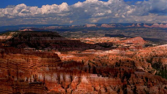 time lapse clouds moving above red rock formations in bryce canyon / utah - bryce canyon bildbanksvideor och videomaterial från bakom kulisserna