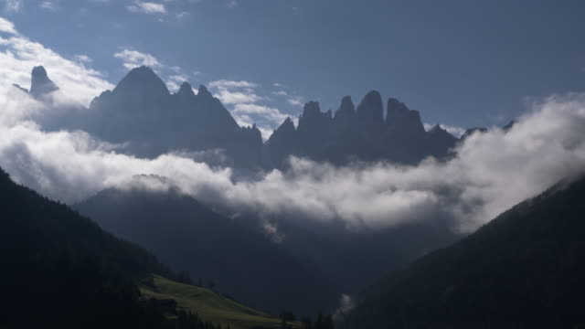 Time Lapse. Clouds moving around the Geisler mountain group at Val di Funes. South Tyrol, Alto Adige, Val di Funes, Geissler Mountains, Dolomites, European Alps, Italy.