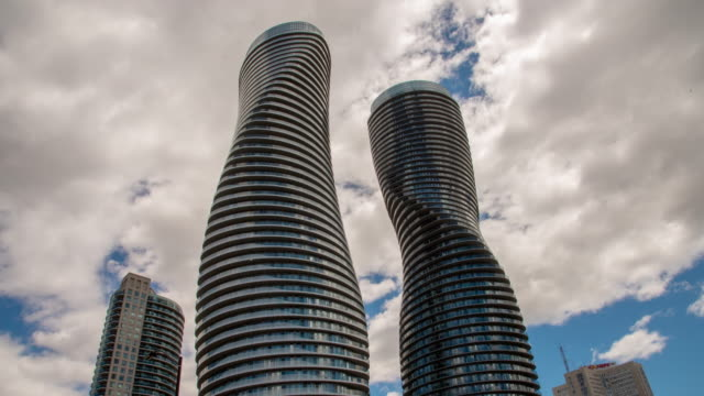 ms time lapse clouds moving over absolute world highrise towers,mississauga,ontario,canada - ontario canada stock videos & royalty-free footage